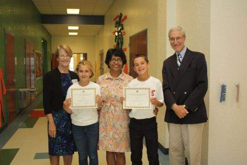 Noreen Fisher, President of The Library Foundation presented certificates and a gift to Young Literary Leaders Alyssa Busch and Lawrence Tatum at Citrus Gove Elementary School with program sponsor Arati Hammond, Realtor® of RE/MAX of Stuart and Dennis Fruitt, Executive Director.